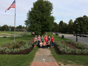 Volunteer group photo between the completed garden beds