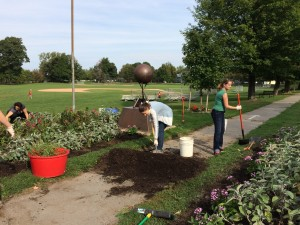 Volunteers shoveling mulch and other activities