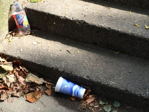 Bottle and cup near stairs