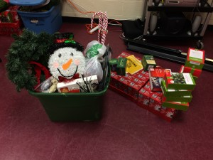 Team 5 - Bin full of decorations with smiling snowman with lights